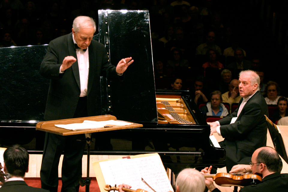 Pierre Boulez conducting the                Chicago Symphony Orchestra, featuring pianist Daniel Barenboim. Photo by Steve J. Sherman