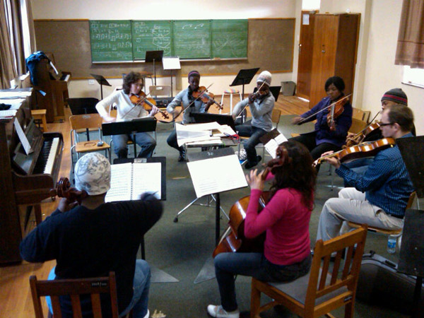 Academy alumni work with students and travel the globe to teach music
